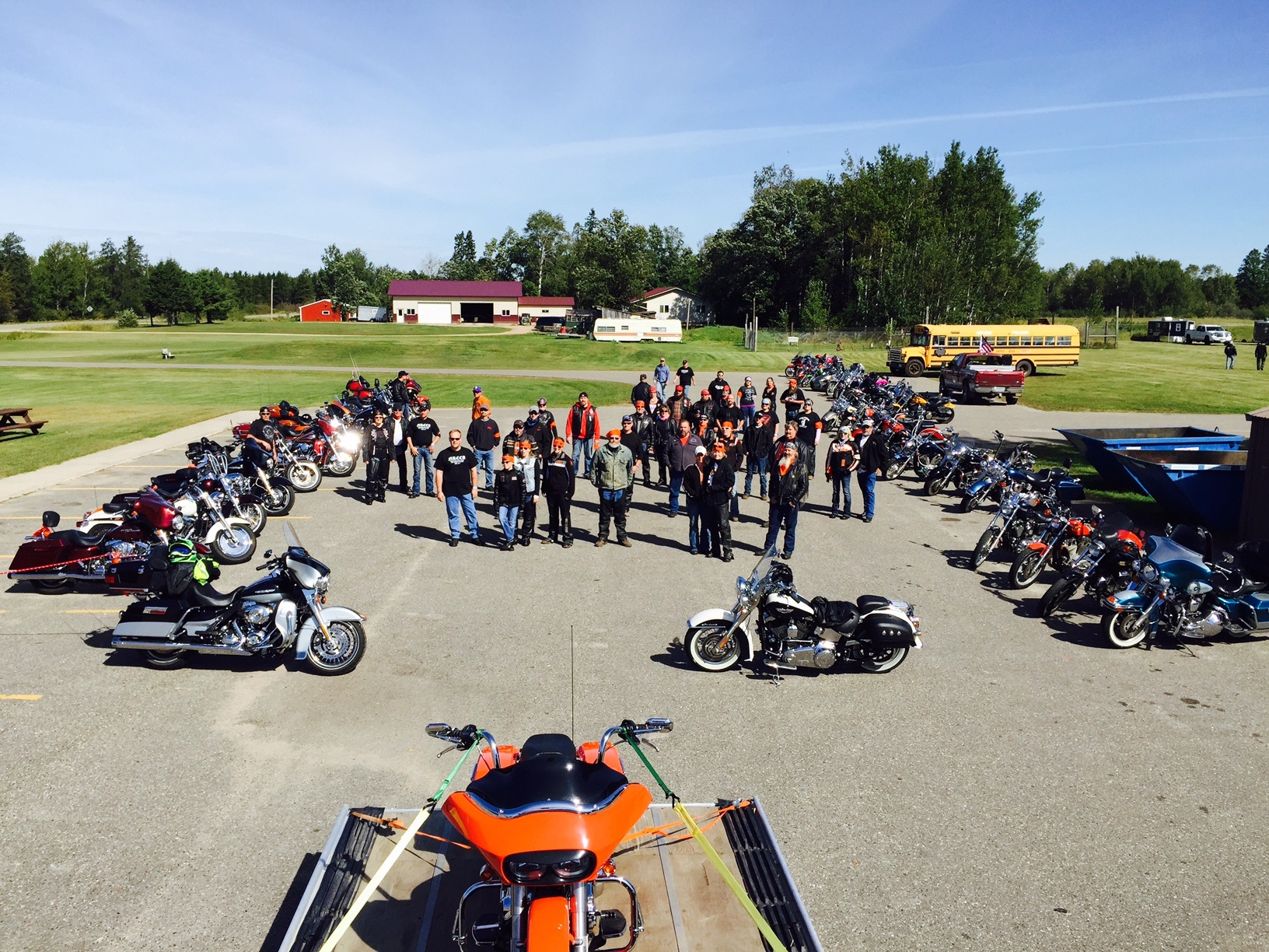 group of motorcycle and riders in the parking lot
