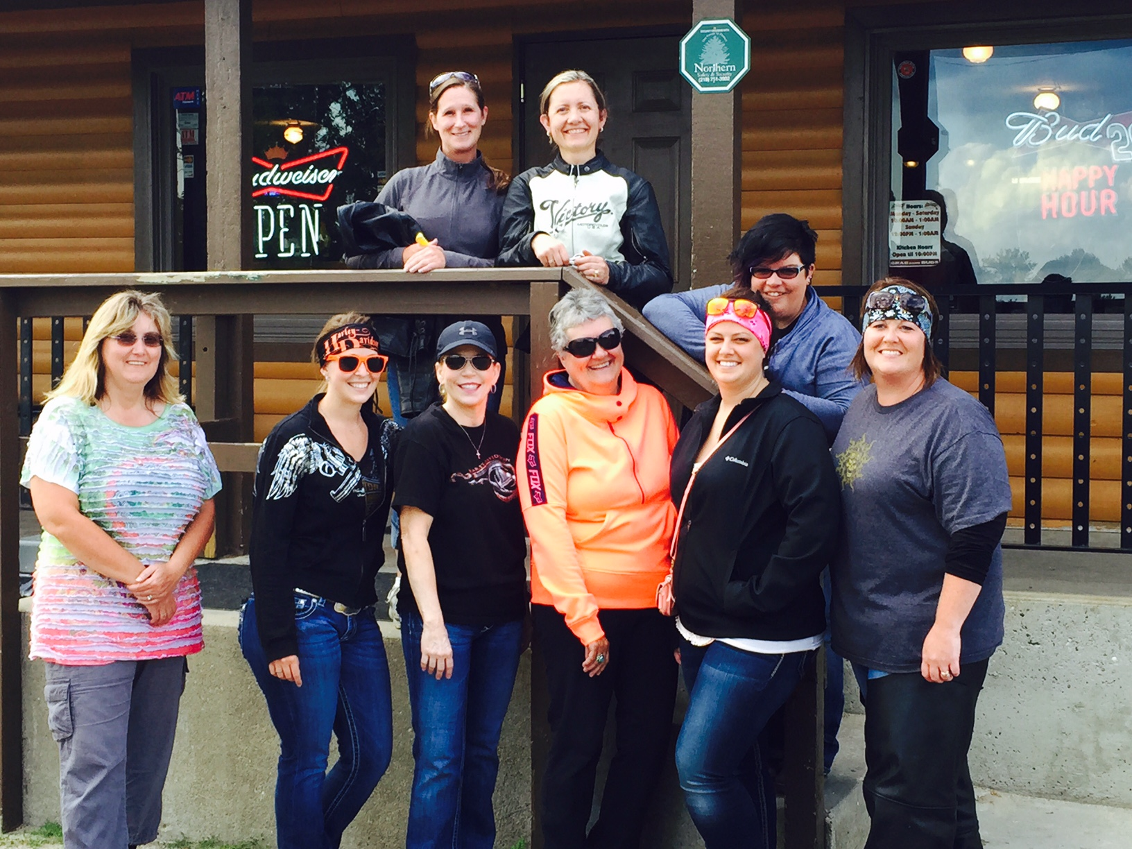 Group of ladies from the ladies only motorcycle ride standing outside Becida Bar & Grill