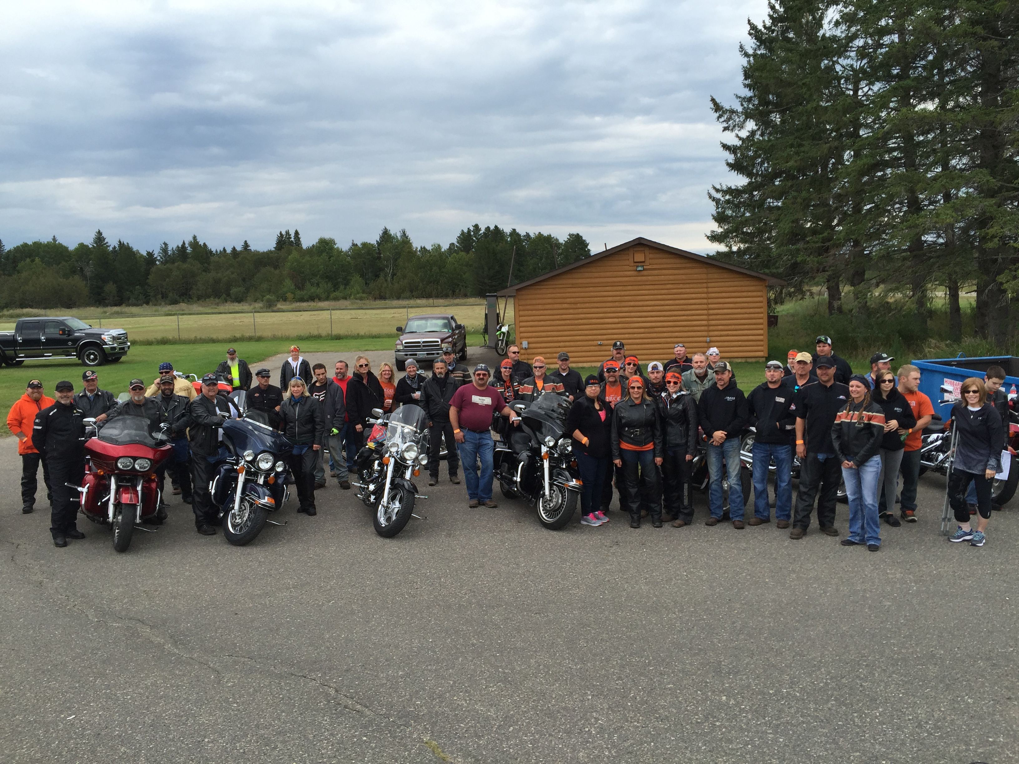 NRCCA group of motorcycles and riders standing in parking lot
