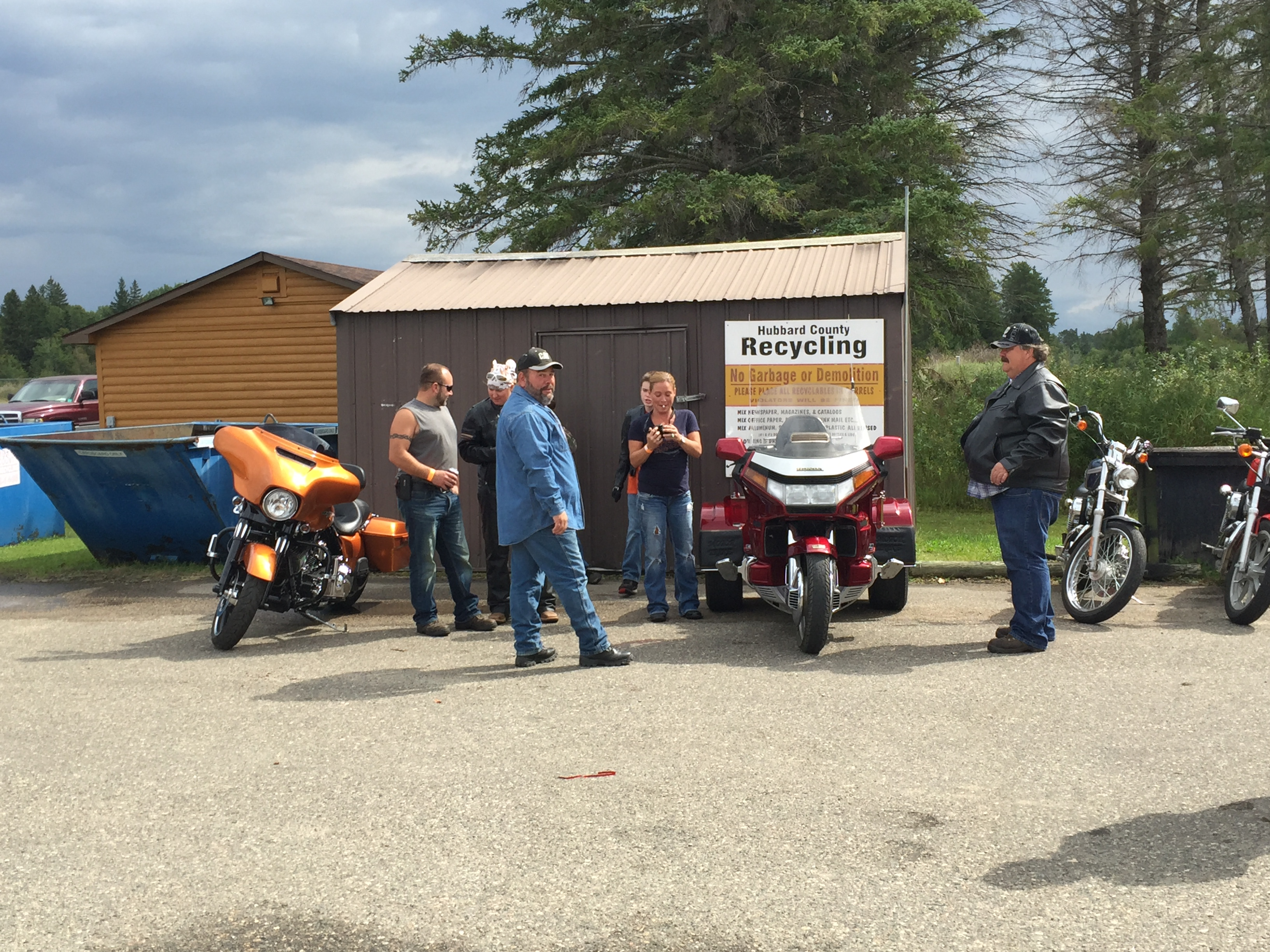 NRCCA motorcycles and riders standing in parking lot